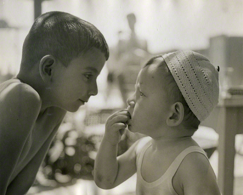 Two young boys staring at each other