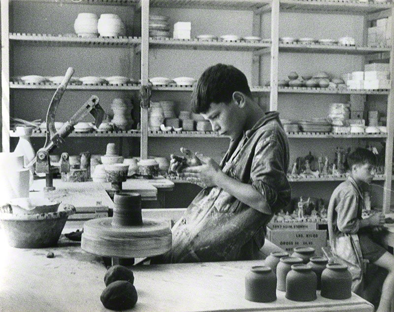 Two boys working in a ceramic studio
