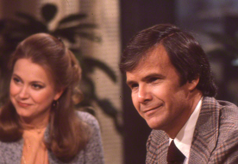 Candid portrait of Pauley and Brokaw on set