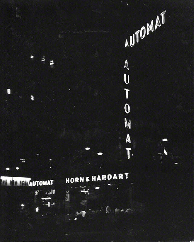 Nighttime view of Horn & Hardart Automat signs