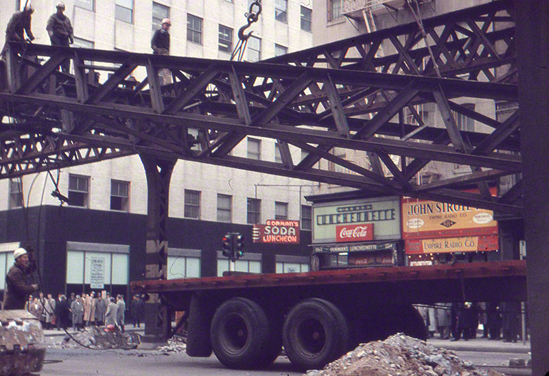 The dismantling and loading of iron beams onto a truck bed
