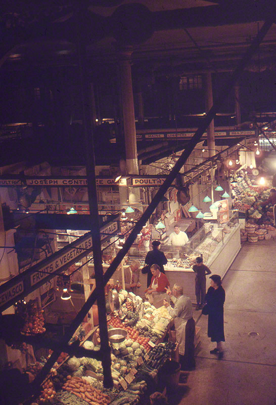 Overhead long view of multiple vendor stalls; customers interspersed