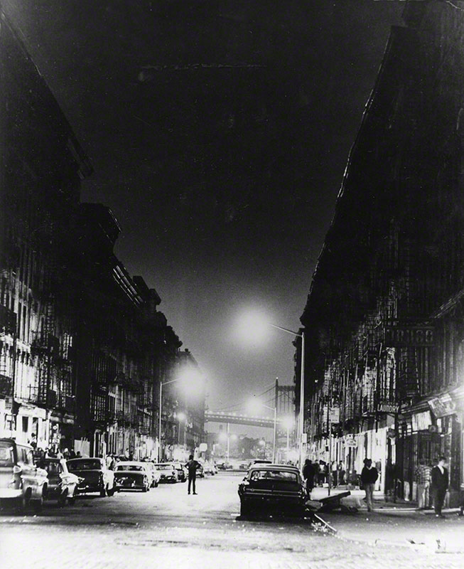 Nighttime view of East 100th St.; high contrast