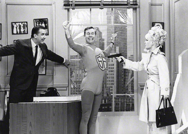 "Carson, McMahon and unidentified woman during a ""superhero"" sketch routine"
