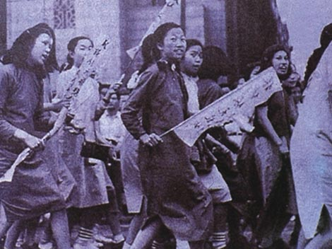 Female students participate in a demonstration as part of the May Fourth Movement, in 1919, defending women's emancipation against anti-imperialism and anti-feudalism. Source: traditions.culture-china.com
