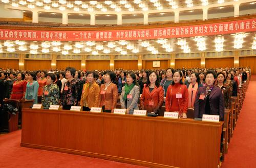 Delegates to the 11th National Women's Congress of China (NWCC) sing together at the closing ceremony of the congress at the Great Hall of the People in Beijing on October 31, 2013. Photo: Women of China/ Zhang Ping