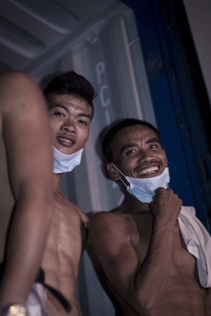 Unloading the truck in the dark was not only heavy work, the fumes from the trailer burned throat and eyes. Breaks were frequently needed for members of the community at Santa Rita who were receiving the goods after their town was damaged by Typhoon Haiyan.