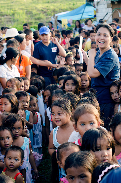 Kids line up to receive school supplies in Marabut, Philippines. - photo by Andy Tillman