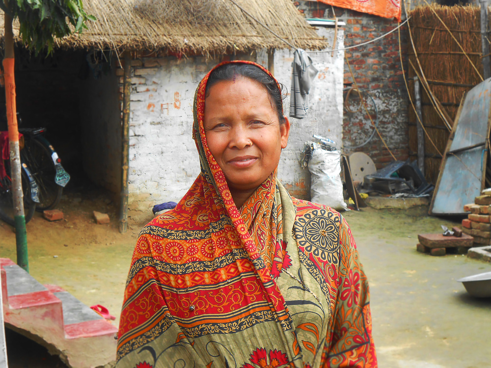 The House that Gayatri Built: Gayatri Devi outside her home. Independently of jobless husband, Gayatri used the higher income from her new job to give their family home walls for the first time. - photo by Don
