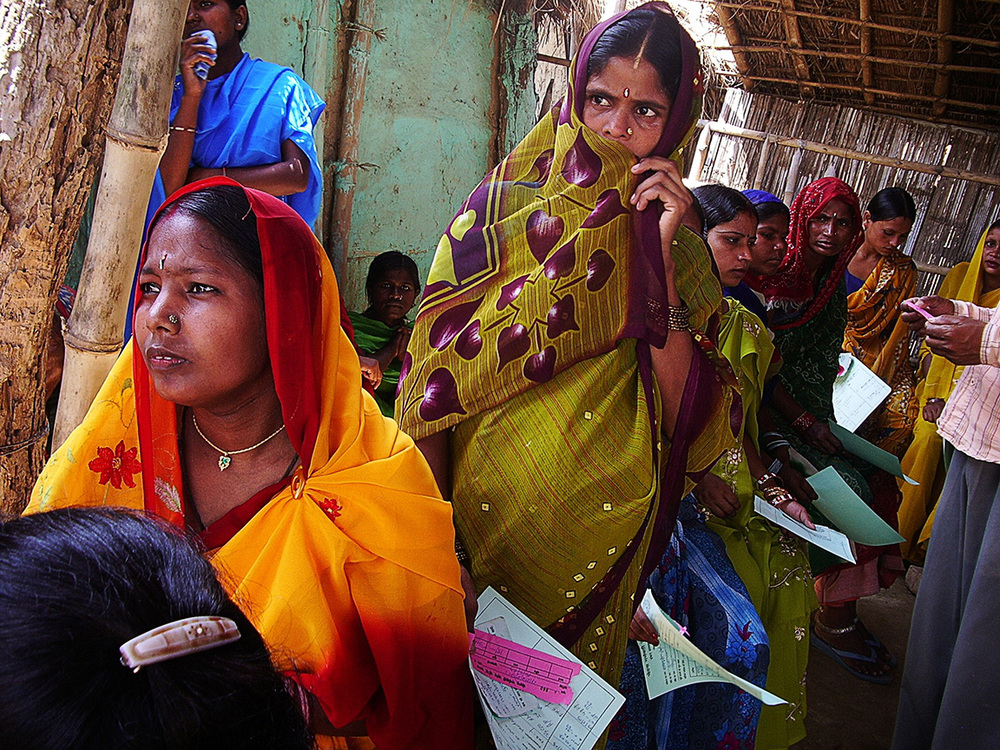 Women in line to sign up for a CHETNA class. - photo by Jenny and Tim