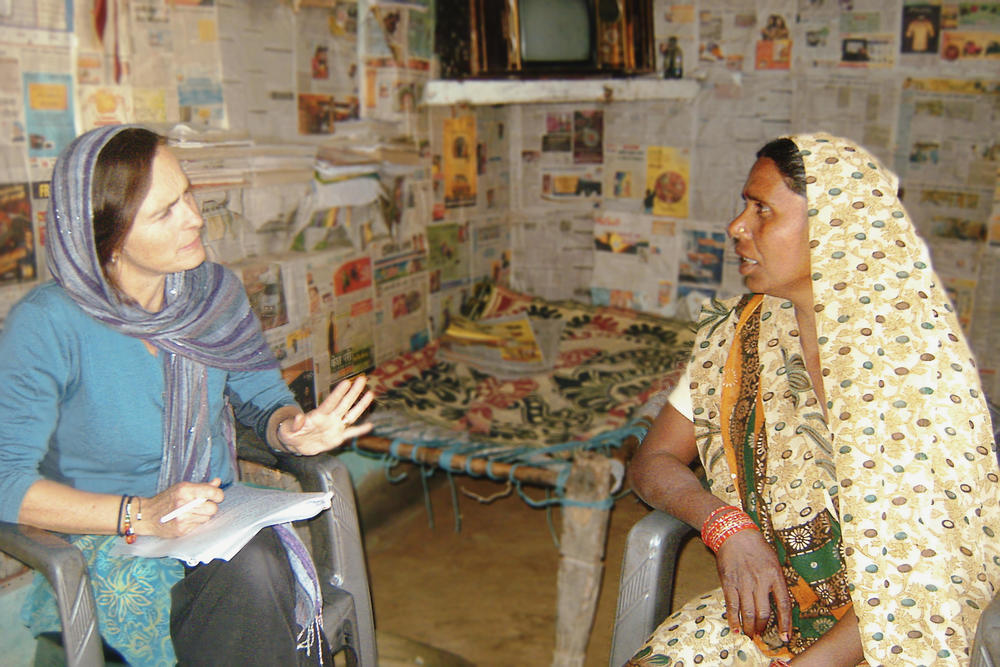 """""""For a long time, mission hospitals and doctors have focused on physical health. Yet there's a very tender vulnerability about mental health that is a really important place for us to be,"""" says Dr. Kaaren Mathias, shown here talking to a woman affected by mental distress. - photo courtesy of Kaaren Mathias"""