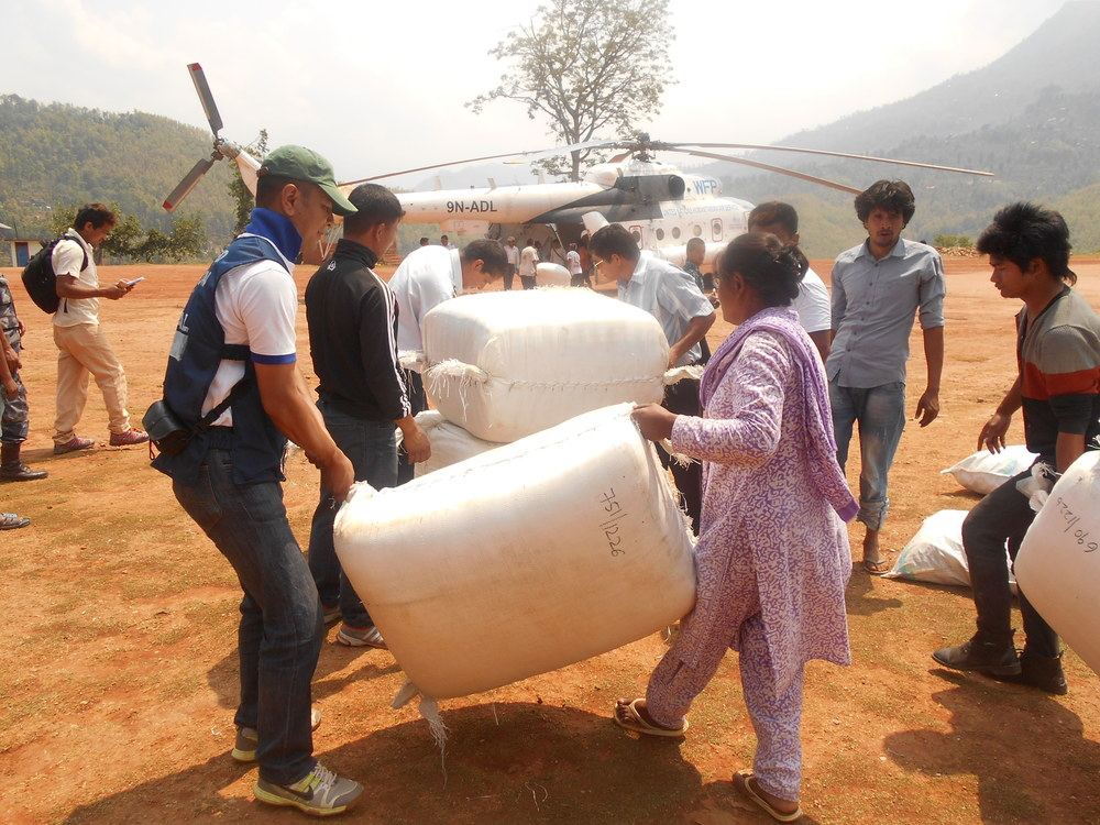 Loading bales of blankets into a helicopter for delivery to inaccessible villages - Photo courtesy of UMN.