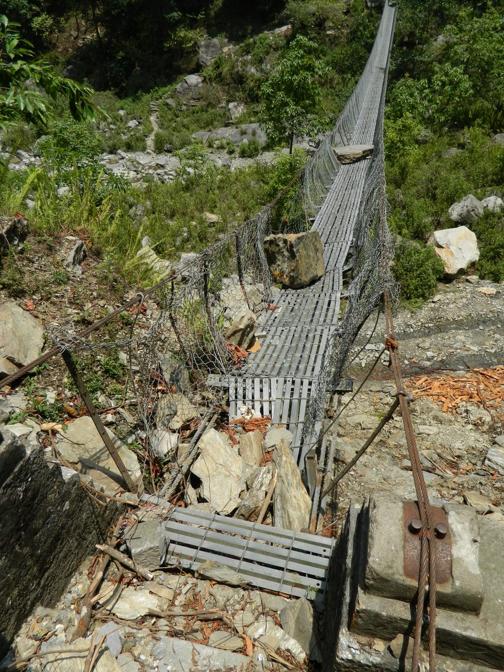 A broken suspension bridge in northern Dhading. Bridges like these are sometimes the only way to reach remote communities by land - Photo courtesy of UMN.