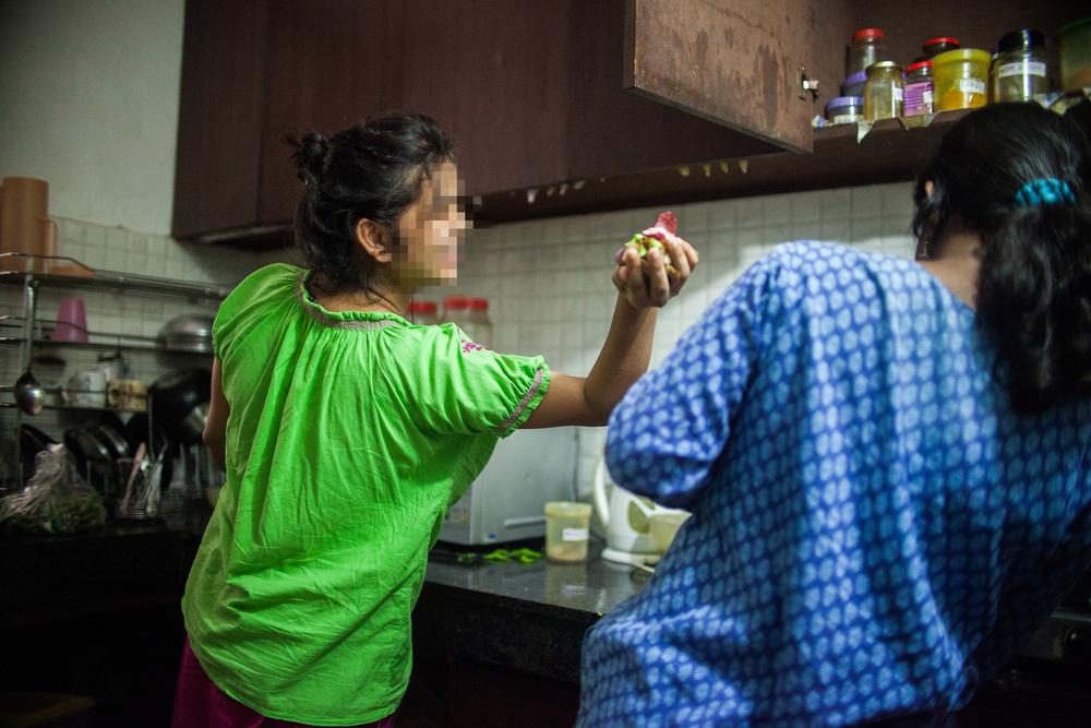 "Two of the women prepare dinner together as part of their daily chores. One of the most life-giving aspects of Beauty for Ashes is the sisterhood fostered between the girls. ""I have found happiness playing with my sisters here. They are very important to me,"" Shreya said."