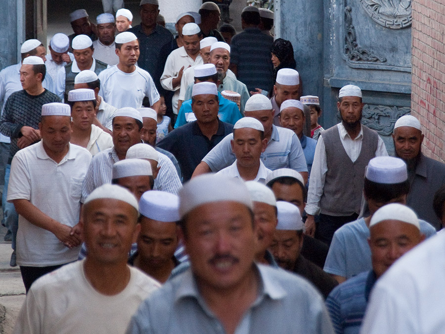 Muslim Hat men returning from prayer - Photo courtesy of  Evgeni Zotov