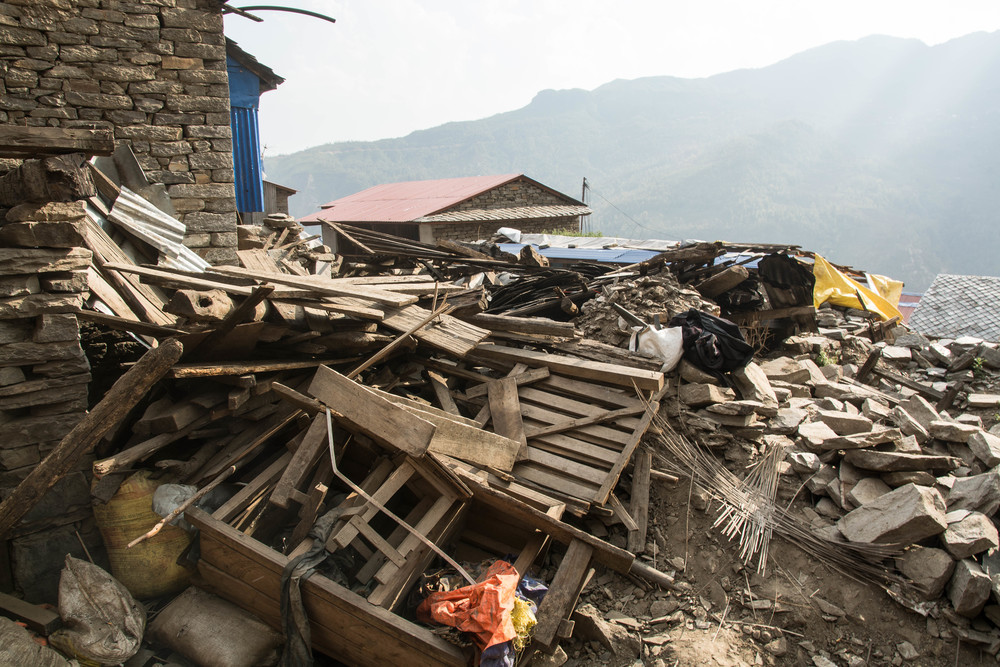 Even a year after the earthquake, many buildings remain in ruins - photo by Mark Morrison.