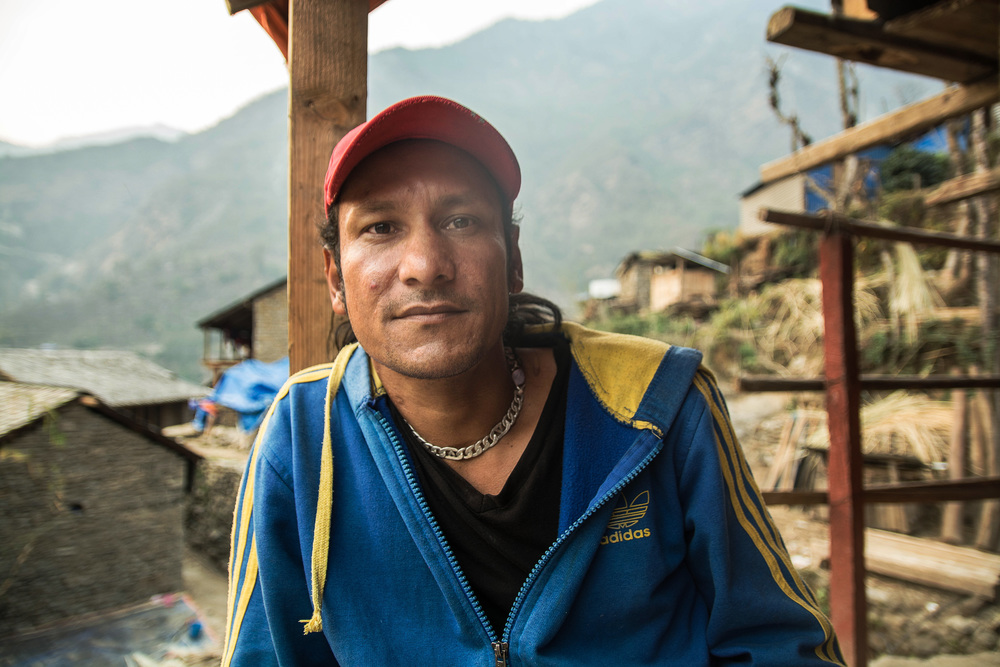 Ram Kumar, a jewelry maker in the village of Tawal, was working in his shop when the earthquake hit - photo by Denise Poon.