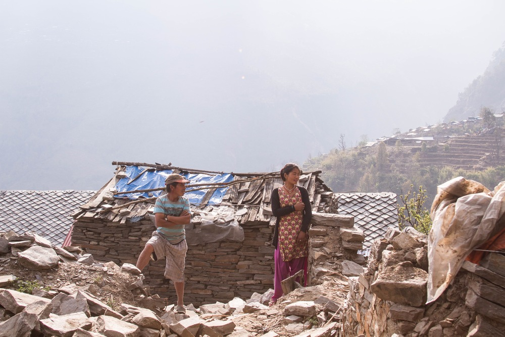 The Nepali government has promised 200,000 rupees (2,000 USD) to each family for rebuilding, but no one in this village has yet received any of the money. The government will not give to any families who have already started rebuilding, so many have left their houses as crumbled heaps, waiting to receive the much-needed funds - Photo by Denise Poon.