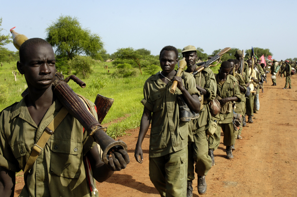 Joseph underwent intense training with the SPLA, learning combat maneuvers, practicing how to use weapons and building up stamina to walk for hours - Photo courtesy of  United Nations Photo .