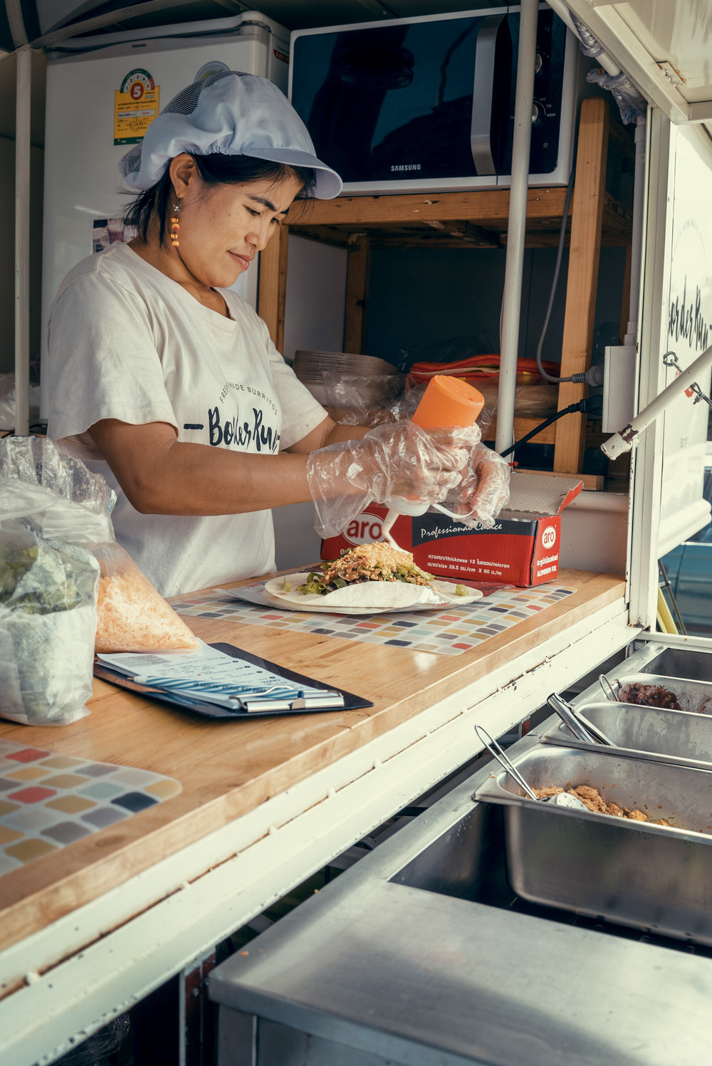 Pawn learned how to make North American food from Laurie, her first American employer and Lauren, who helped her set up Border Run - photo by Chad Loftis.