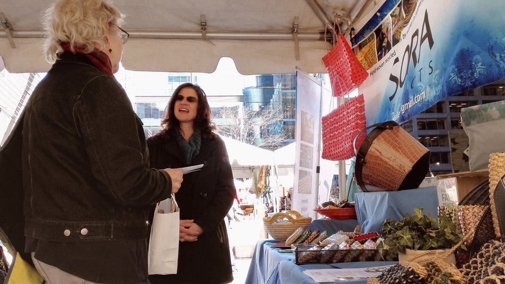 Amy sells Chora products in a market in downtown Chicago - Photo by Ghie.