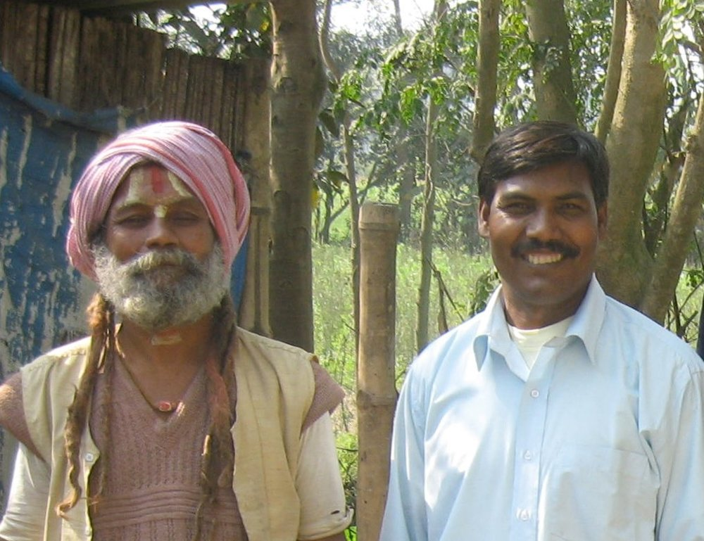 Madhu and a villager coming from a religious ceremony. Madhu's work relies on the strength of the relationships he builds with the volunteers and villagers he works with - Photo courtesy of Brian.