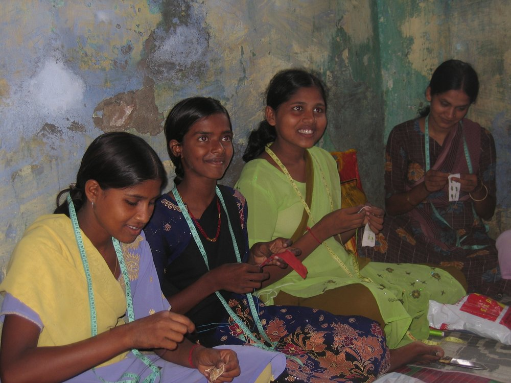 Learning to sew means girls can make not only their own clothes, but start earning a small income making them for others - Photo courtesy of Brian.