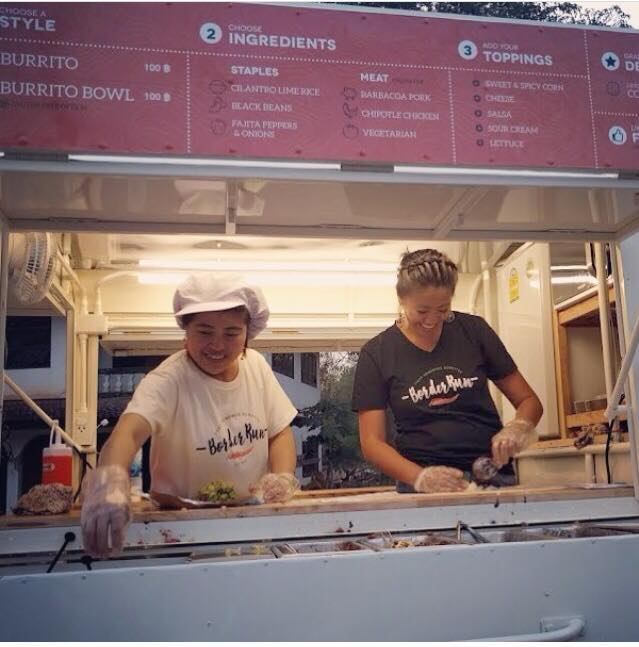 Lauren (right) and Pawn preparing Burritos together in the Border Run food truck that Lauren helped Pawn start - Photo courtesy of Lauren Sauder.