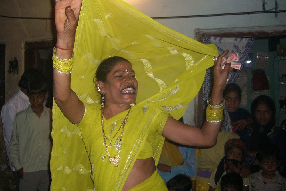 A hijra dancing at an auspicious event is believed to bring good luck and blessing. - Photo courtesy of Creative Commons.