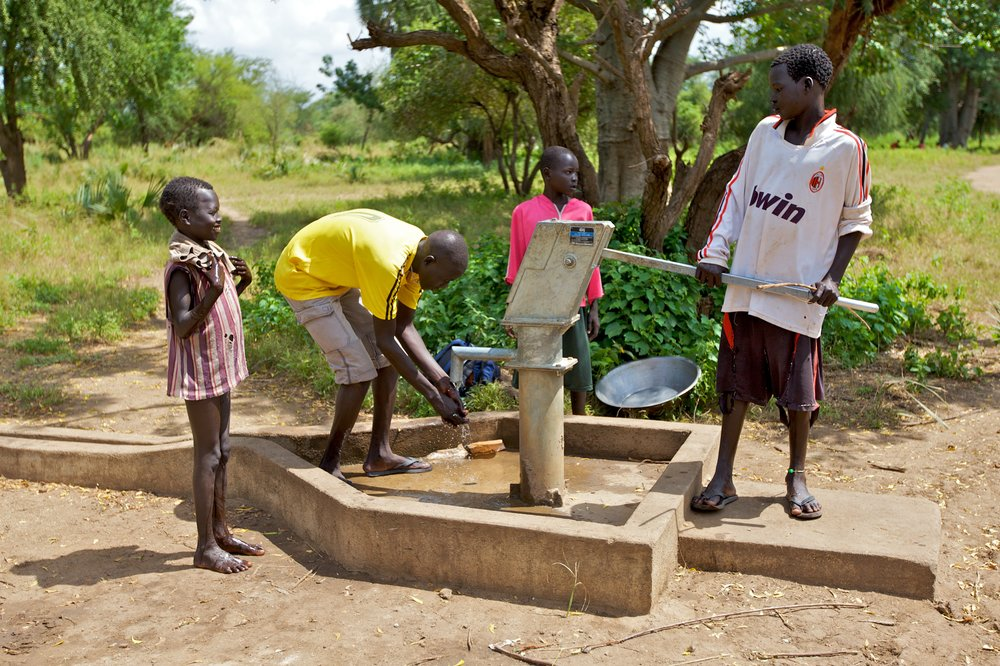 Young men use a borehole installed by SIM