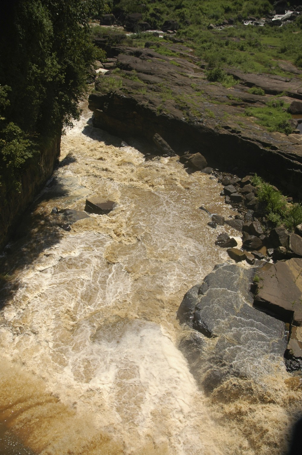 A river in the central highlands during the Monsoon, Sri Lanka loses 1 kg of top soil for every cubic meter of water during the monsoonal period.