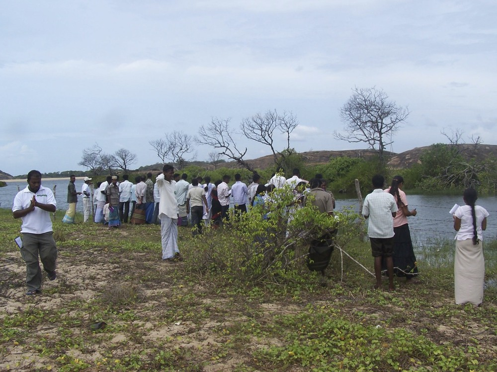 Photo: Tsunami affected Panama Lagoon Sri Lanka. A field visit with community leaders, to design Analog  forestry models for  restoration. (The dead trees in the back ground were the result of the 2004 Tsunami.)