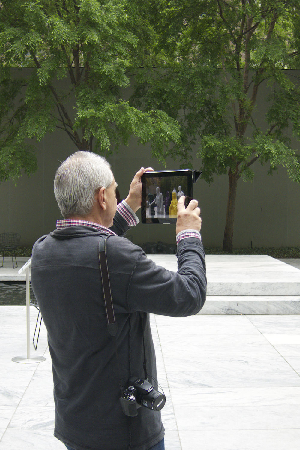 NYC Icons: Hip iPad Photographer at MoMA