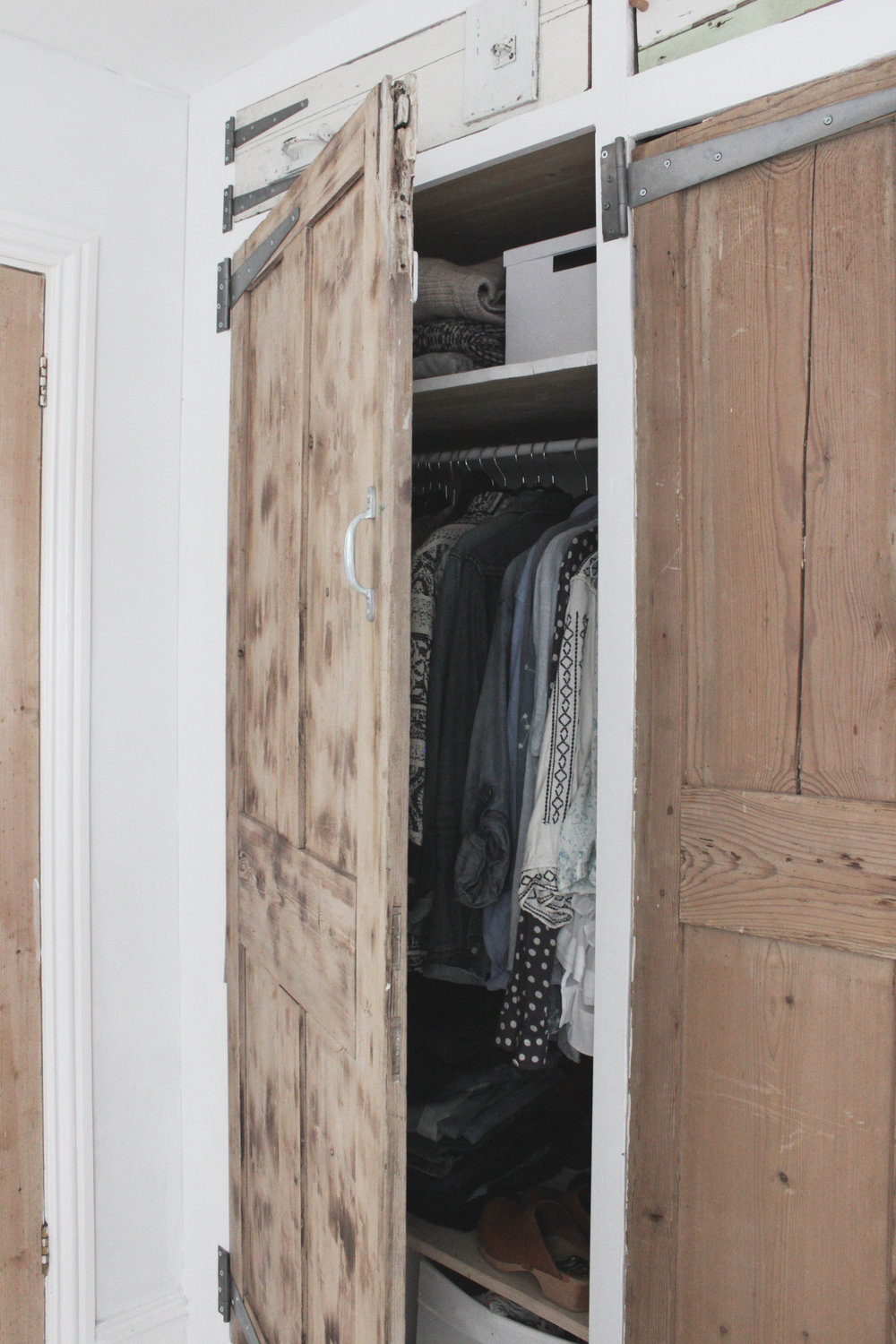 Build a faux build in wardrobe using reclaimed doors and an Ikea Ivar frame, tutorial by www.hestershandmadehome.com