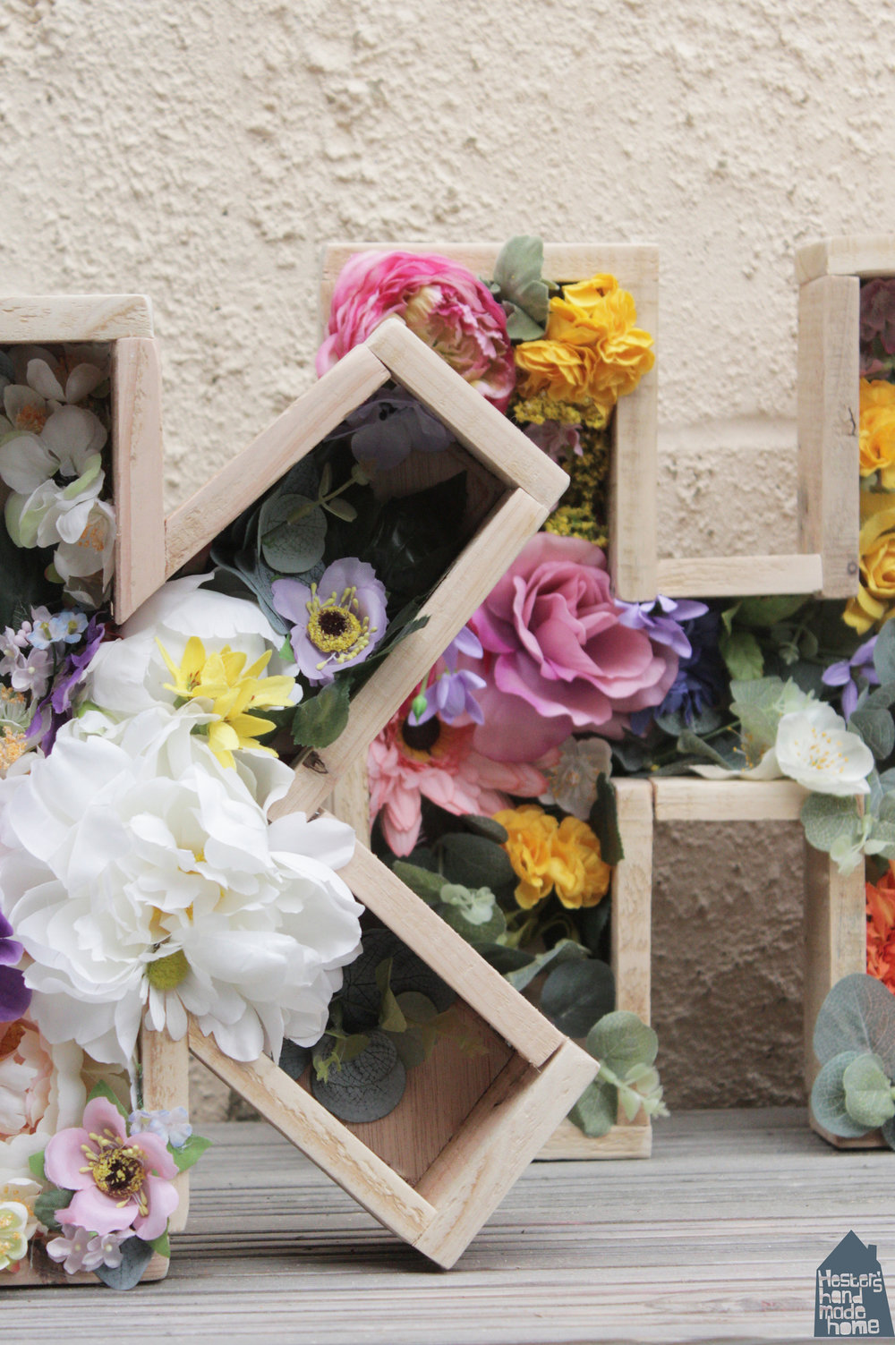 Pallet wood letter planters filled with faux flowers, tutorial by Hester's Handmade Home taken from her latest book Pallet Wood Projects for Outdoor Spaces