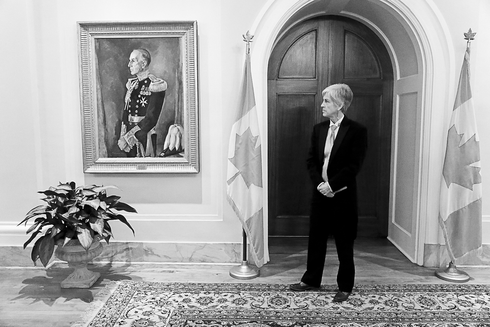 Professor Lorraine Gilbert contemplates the official portrait of former Governor General Georges Vanier