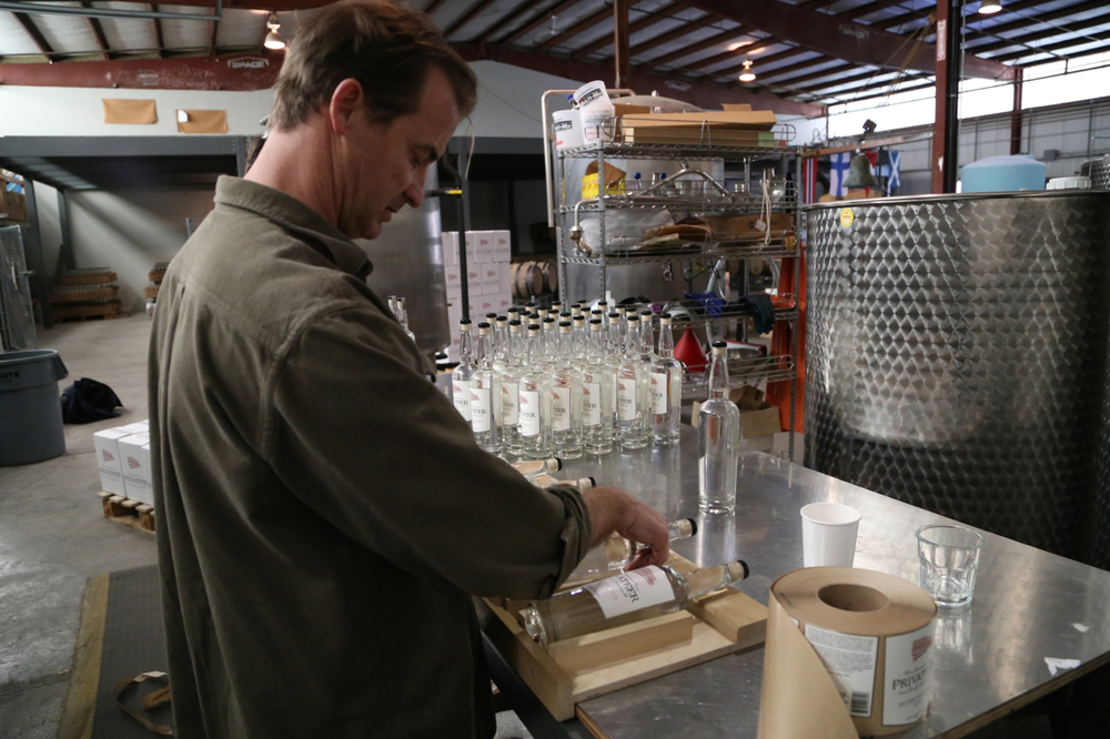 Founder Andrew Cabot labels bottles by hand.