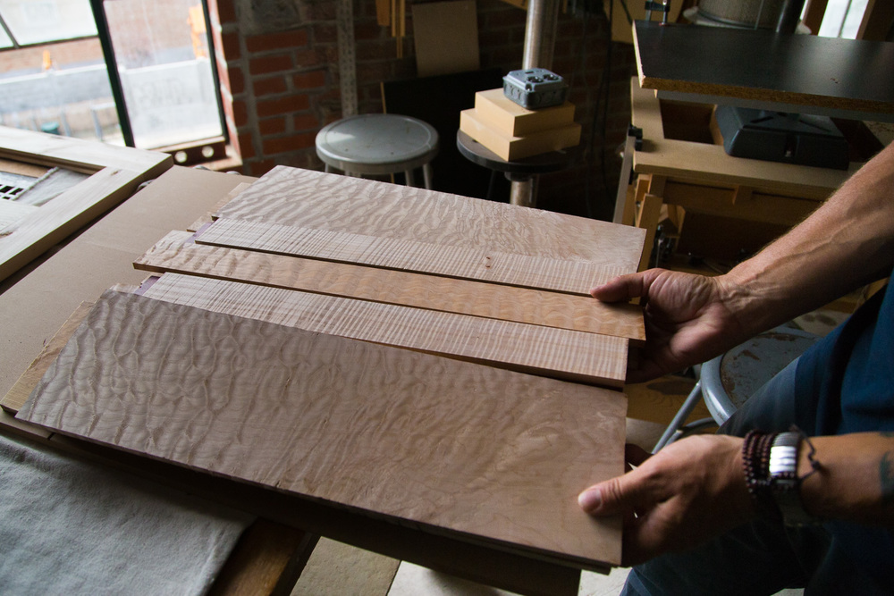 Moyer is working on the body of a double-necked bass guitar.