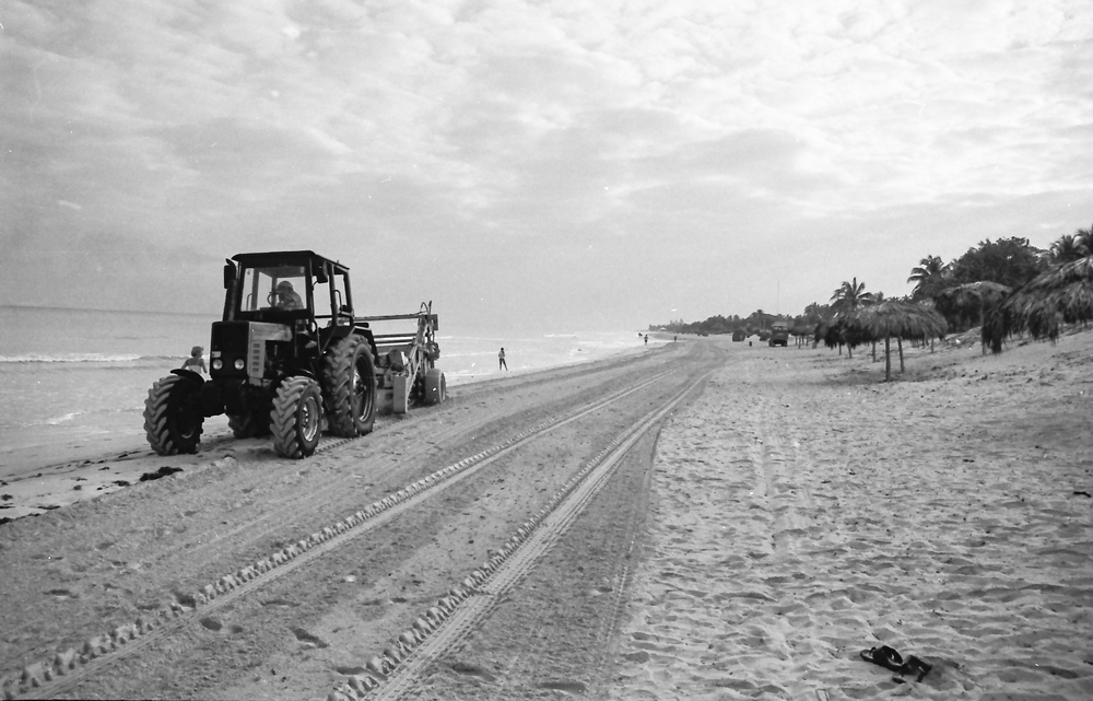 Grading the sand at the tourist beach, Varadero.