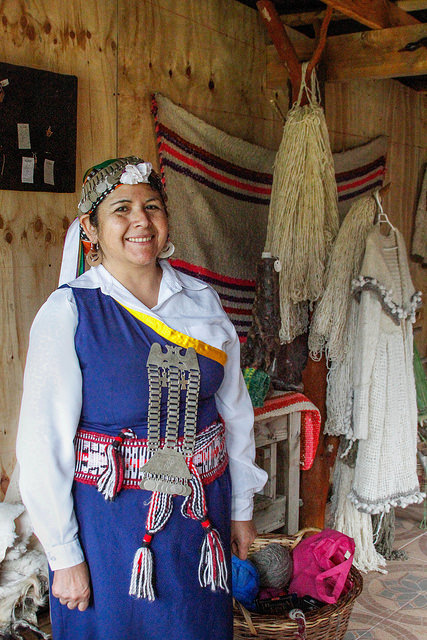 Michaela, one of the members of the Mapuche tribe wearing their traditional clothing.
