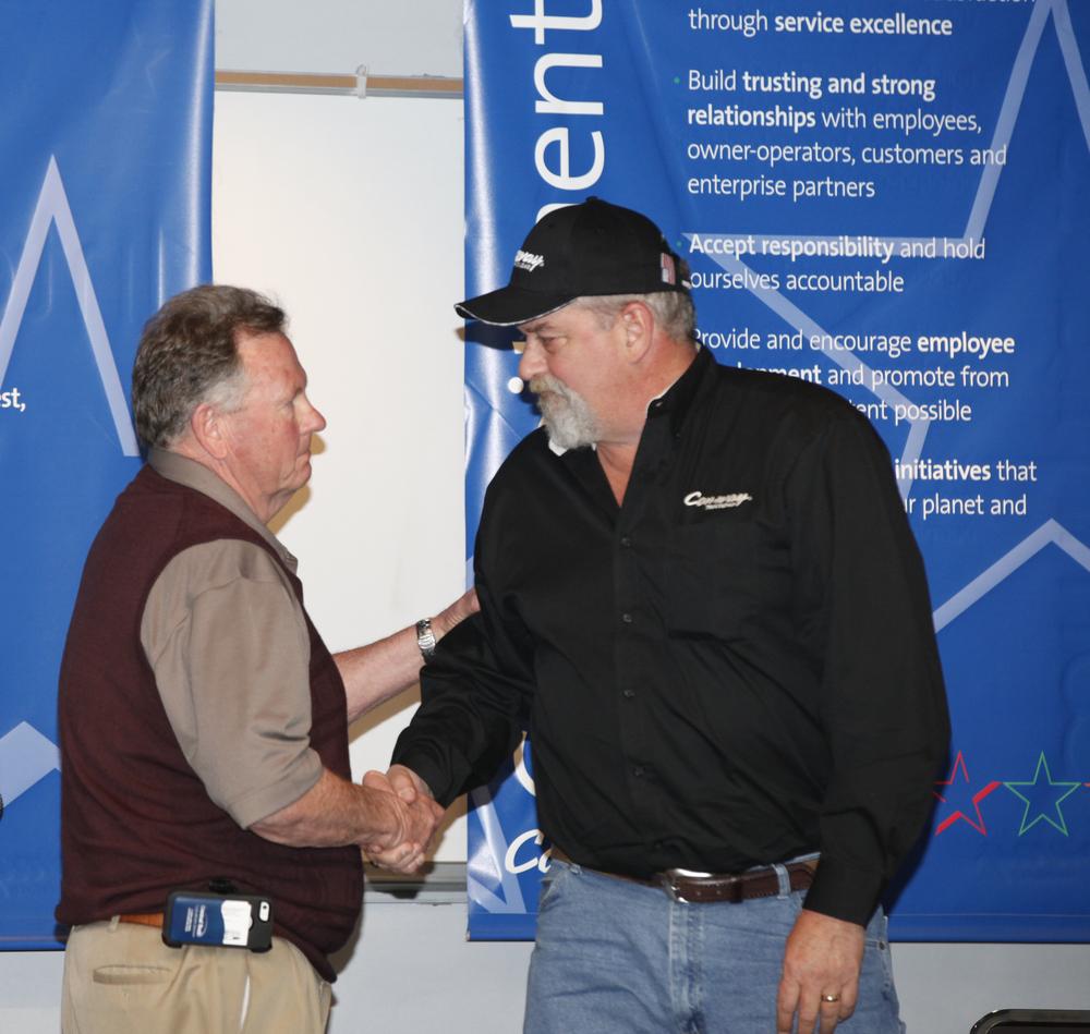TAT Board President Mark Brown, left, congratulates Kevin Kimmel on his award.