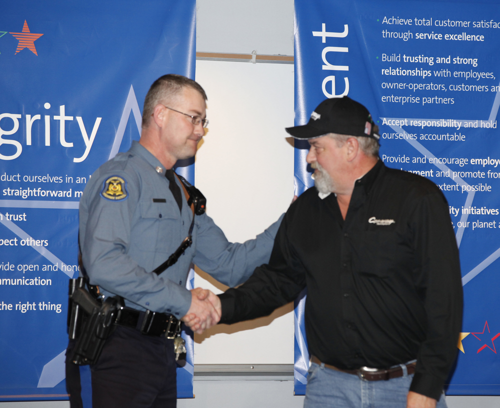 Missouri State Highway Patrol Trooper Clint Mason thanked Kevin Kimmel for making the call that resulted in the recovery of a trafficking victim and the arrest of the perpetrators.