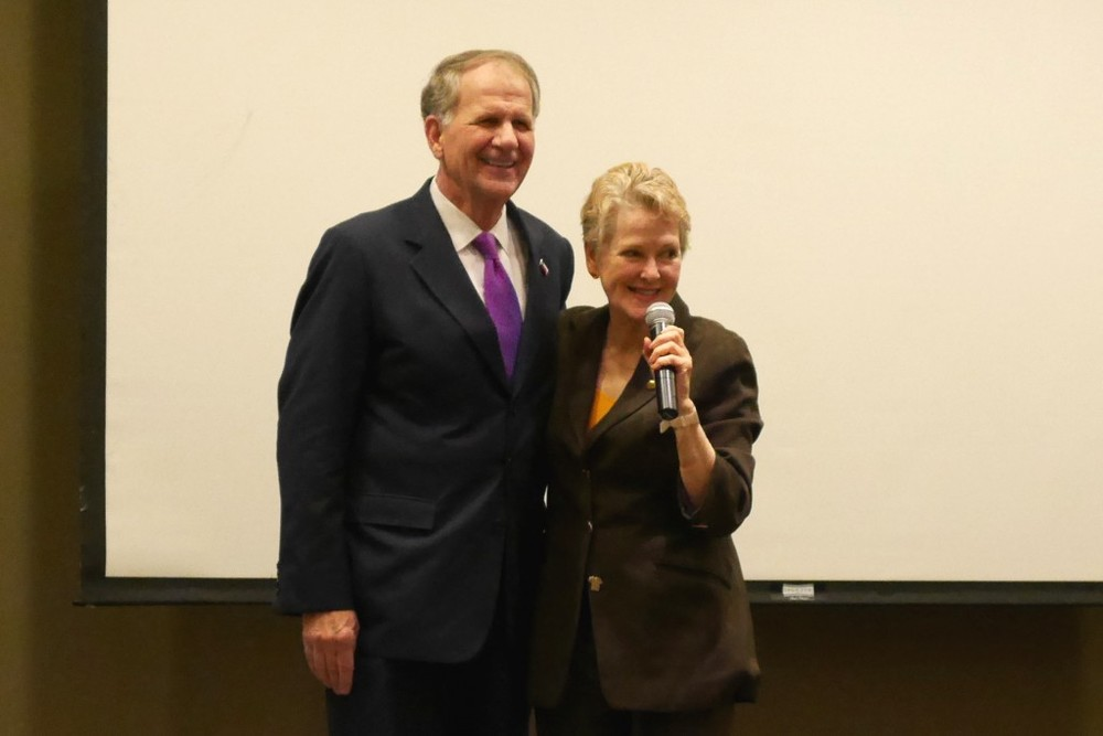 Ambassador Swanee Hunt introduces Senator Ted Poe before he addressed the crowd at Cease and Desist