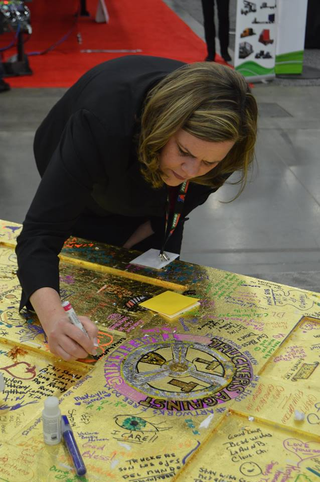 Alison Taylor, assistant attorney general for Kentucky, signs the Golden Door to Freedom.
