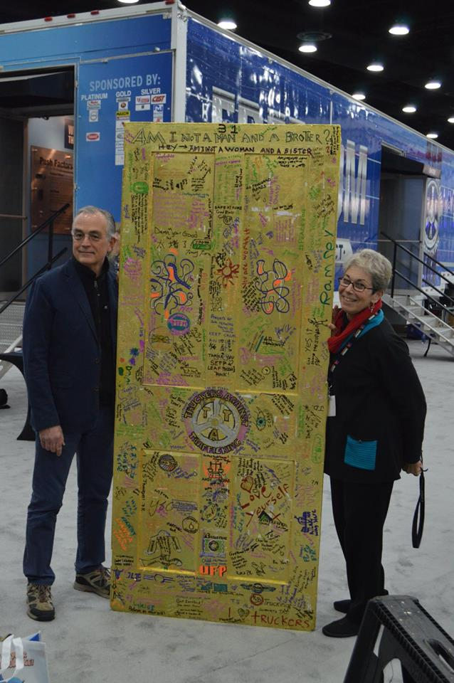 ArtWorks for Freedom Master Gilder Bill Adair and Creative Director Kay Chernush flank the completed Golden Door to Freedom.
