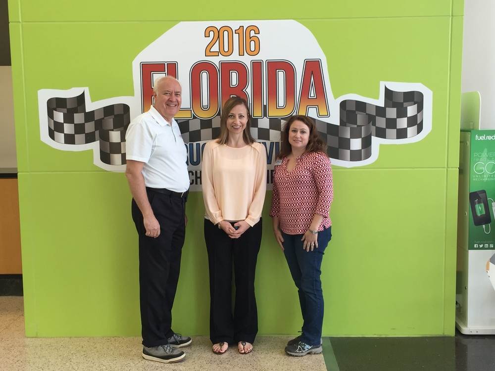 Kylla Lanier, (Center), tat deputy director, flanked by Ken Armstrong, president of the florida trucking association (fta), and tisha keller, vice president of the fta, recently spent time talking about human trafficking with fta members at  the florida truck driving championship.