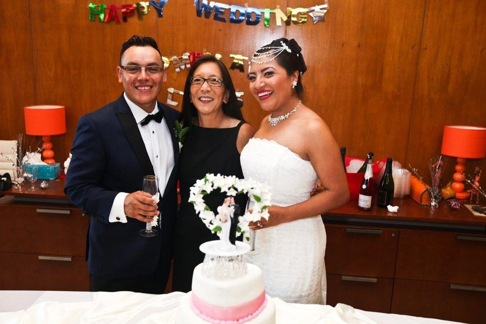 Human trafficking survivor Carmen (r.) married her fiancé, Luis (r.), in a ceremony officiated by Judge Pamela Chen (c.), who prosecuted Carmen's traffickers. (BYRON SMITH FOR NEW YORK DAILY NEWS)