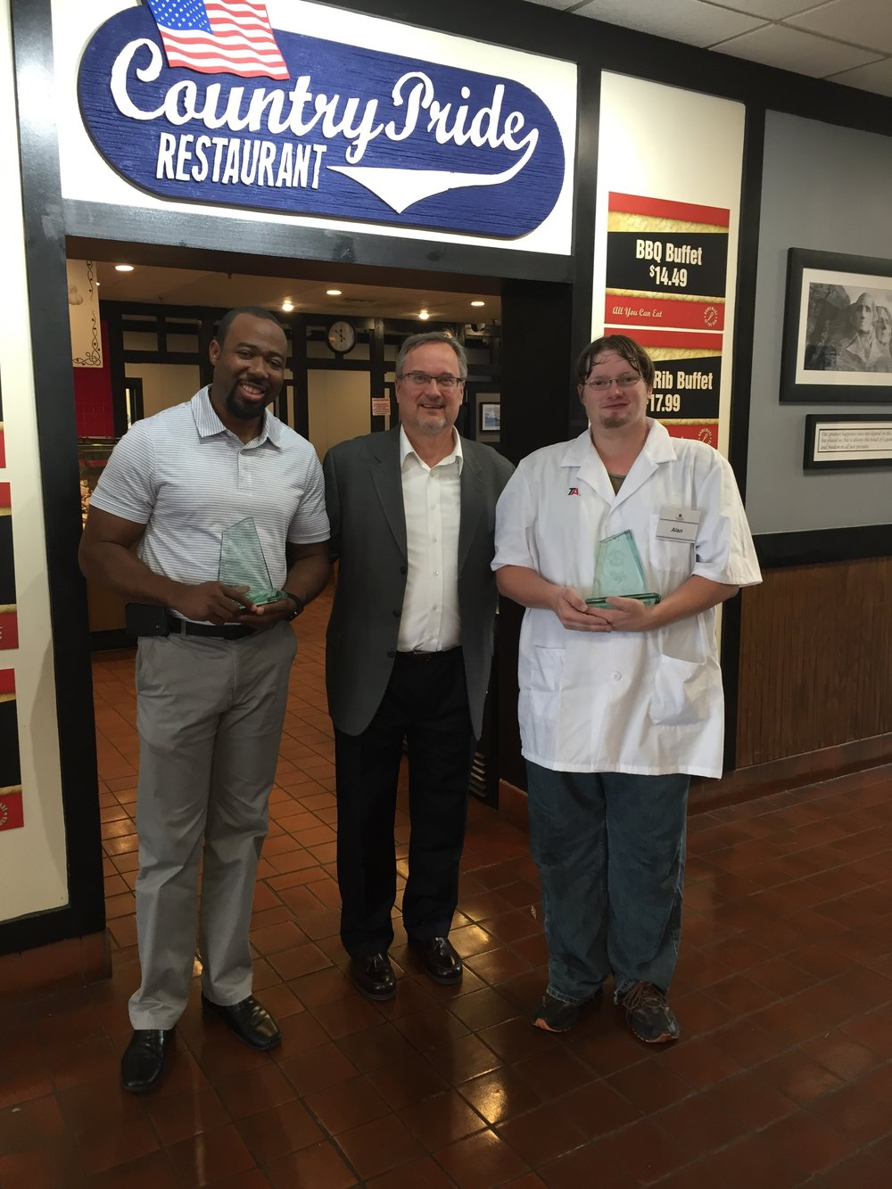Tom Liutkus (center), senior vice president of marketing and public relations for TravelCenters of America, presented the Harriet Tubman award to Debo Adepiti (left), TA general manager at Jessup, and Alan Bailey (right), porter.