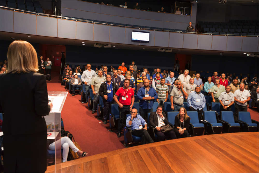 TAT Deputy Director Kylla Lanier (left) asked truck drivers to stand at the Childhood Brasil conference to receive a standing ovation.