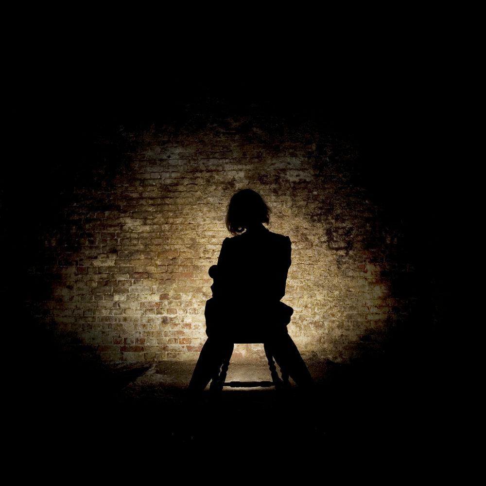 Girl sitting in shadows.jpeg